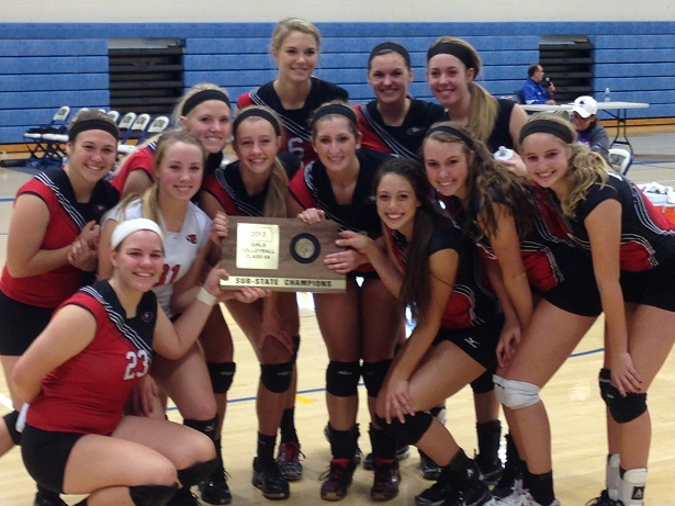 Volleyball team members hold Sub-State Champion award
