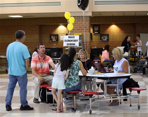 Families enroll at Maize USD 266 during the annual One Stop Enrollment event.