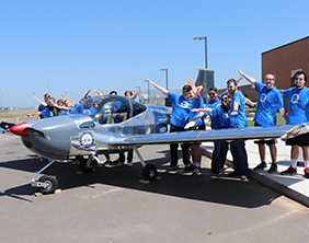 Maize USD 266 students pose with the airplane they built during the 2018-19 school year.