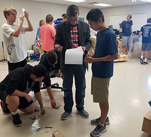 Maize USD 266 high school students build an airplane in class.