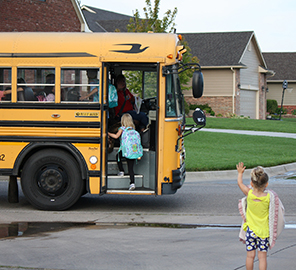 A student boards a Maize USD 266 school bus.