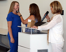 A student is honored during her pinning ceremony at the Maize Career Academy.