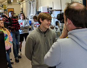 Sophomore Isaac Stanton , founder of the Maize High School Climate Club, is interviewed by KAKE-TV.
