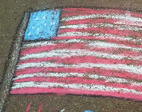 Children's chalk art of U.S. flag.