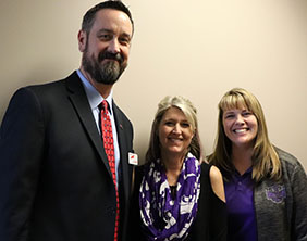 Dr. Chad Higgins, Superintendent, with Michelle Hilliard and Dr. Kristy Custer