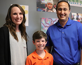 Maize South Elementary School's Stephany McClellan and Glen Shafer with Keegan Dalton
