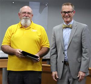 Dr. Jeff Jarman, Maize Board of Education President, recognizes  Maize Recreation's Brad Naccarato