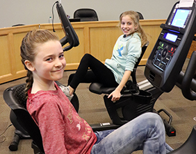 Maize Central Elementary School fourth-grade students Raegan Casey, left, and Norah Morrow demonstr