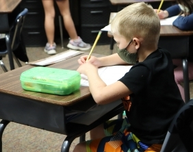 A Maize USD 266 student works on an assignment in class.