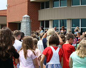 Maize South Elementary School students celebrate their outdoor Lighthouse Ceremonies.